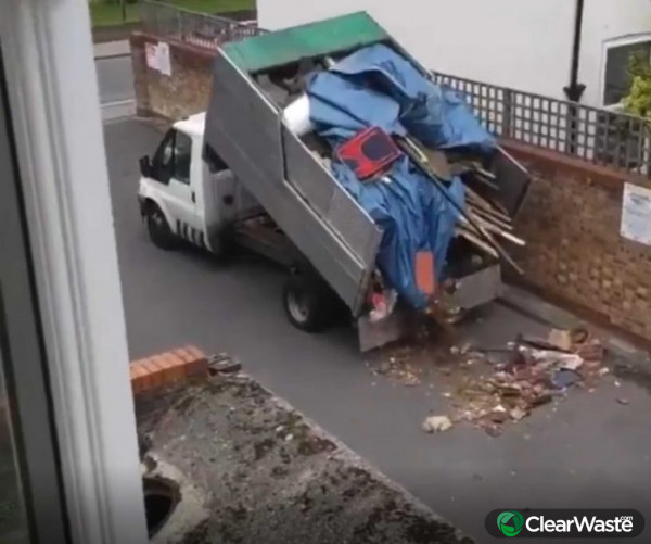 Image from: 'Brazen moment fly-tipper is caught depositing entire lorry full of waste onto residential street'